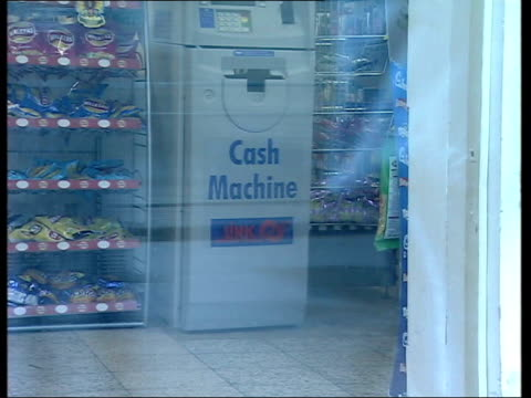 ext cms sign 'cash machine here link' gv cash machine as seen through shop window ls post office cms 'post office' sign tilt down to sign advertising... - fee stock videos & royalty-free footage