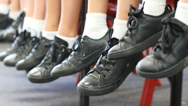 feed of primary school students sitting - footwear stock videos & royalty-free footage