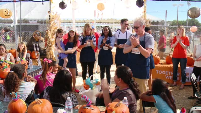 ATMOSPHERE Feeding America And The Los Angeles Regional Food Bank Host Holiday Harvest Volunteer Event at Shawn's Pumpkin Patch on October 24 2015 in...