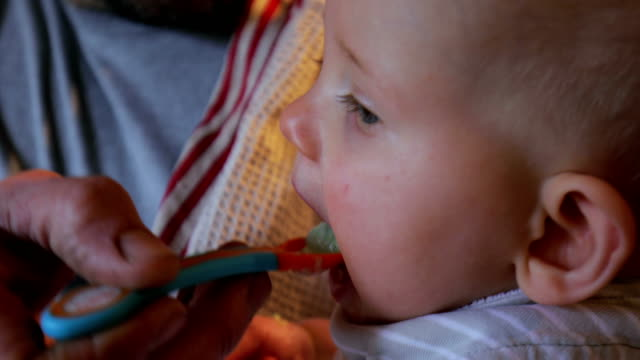 feeding the baby - role reversal stock videos & royalty-free footage
