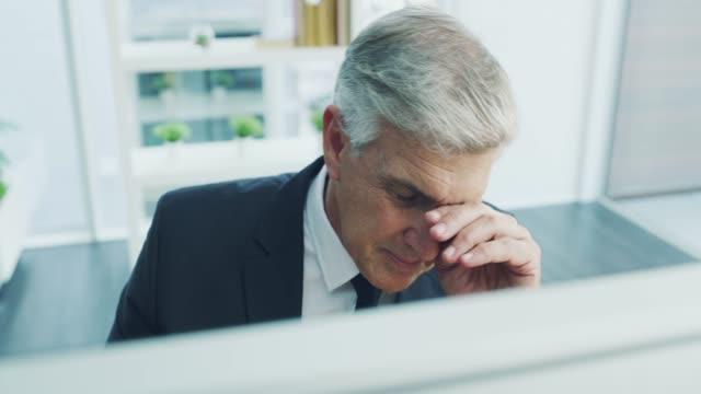 feeling a bit overworked - headache stock videos & royalty-free footage