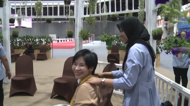 feeling exhausted after reporting on asian politics and diplomacy help is at hand at this year's asean summit in thailand with a team of masseurs on... - diplomacy stock videos & royalty-free footage