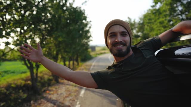 känn dig fri under roadtrip i bilen - handsome people bildbanksvideor och videomaterial från bakom kulisserna