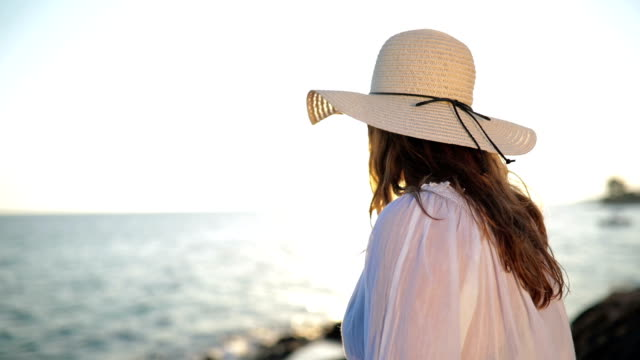 feeling summery in her sunhat - sun hat stock videos & royalty-free footage