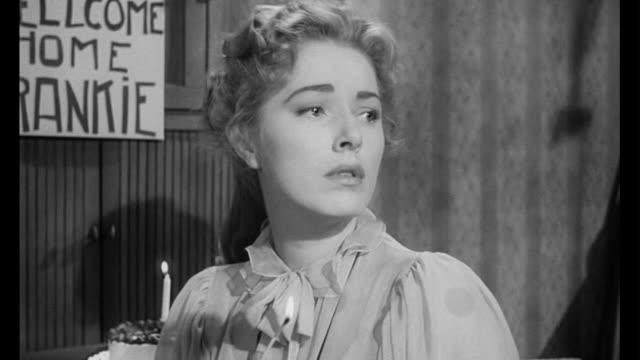 1955 feelings are hurt when man (frank sinatra) refuses to eat handicapped woman's (eleanor parker) cake - 依存点の映像素材/bロール