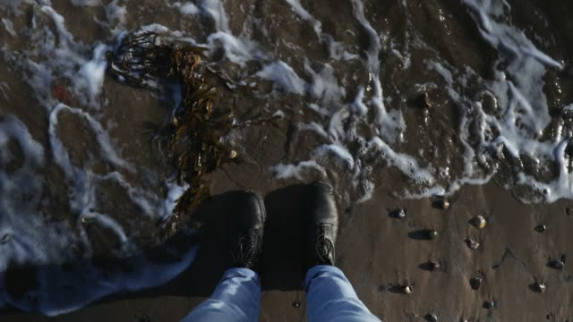 feet at waters edge - northumberland coast stock videos & royalty-free footage