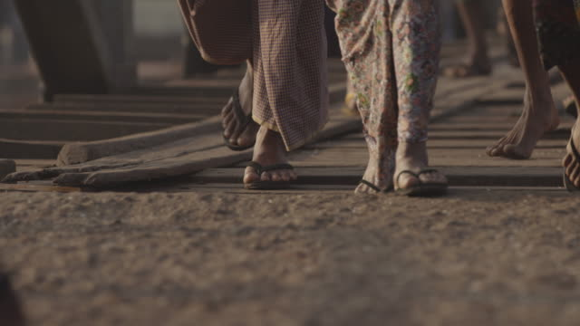feet bustle on busy boat dock in myanmar - barefoot stock videos & royalty-free footage