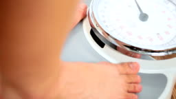 Feet in Close-up on Weighing Scales