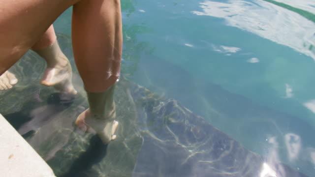 feet in pool - human limb stock videos and b-roll footage