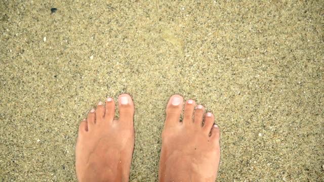 Feet in water.