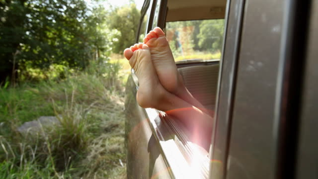feet of a child sticking out of car window - little girls bare feet stock videos and b-roll footage
