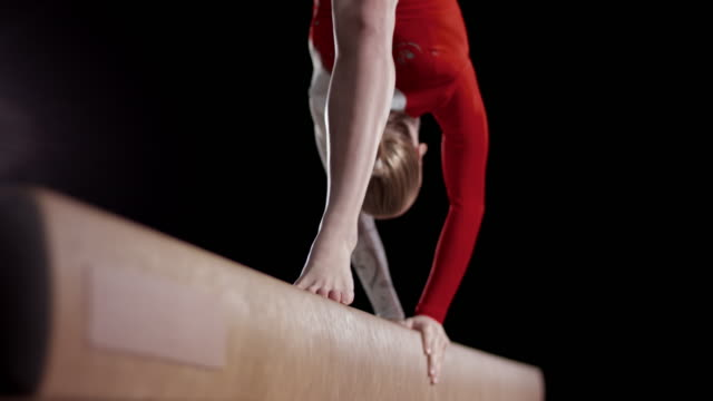 slo mo feet of a female gymnast while doing a back walkover - leotard stock videos & royalty-free footage