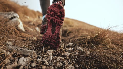 slo mo feet of a female runner pushing gravel and dirt into the air - focus concept stock videos & royalty-free footage