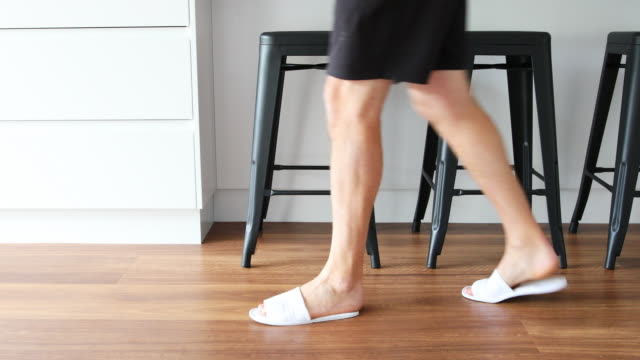 feet of a man in slippers walking through a kitchen - slipper stock videos & royalty-free footage