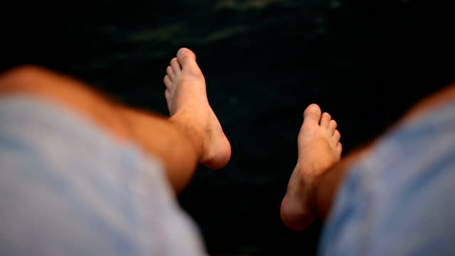 Feet of a man playing on the per