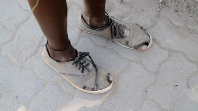 cu feet of a poor african teenager - begging social issue stock videos & royalty-free footage