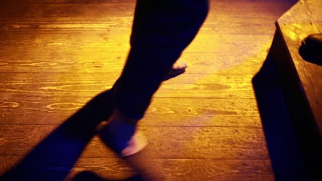 feet of a woman dancing on dance floor in night club - rhythm stock videos & royalty-free footage