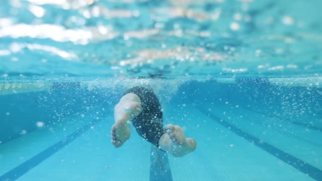 feet of adaptive athlete swimming - geographical locations stock videos & royalty-free footage