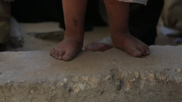 Feet of children in a poor area of Gaza on October 23 2016