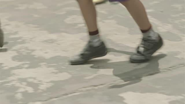 vídeos de stock, filmes e b-roll de feet of children playing and running - venezuela