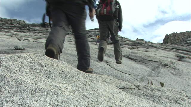 feet of climbers at mount kinabalu in malaysia  - mt kinabalu stock videos and b-roll footage