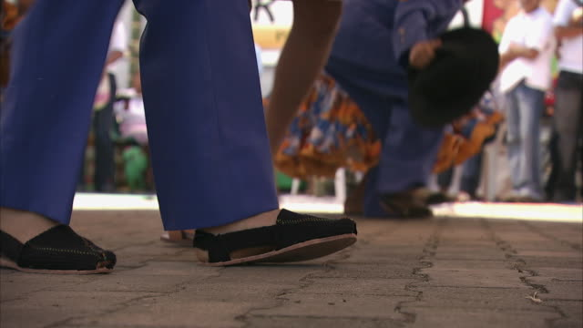 MS Feet of dancing children as they perform / Bogota, Colombia