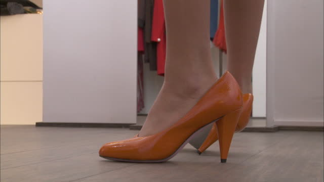 cu feet of girl (10-11) trying on too big high heel shoes in fitting room / brussels, belgium - pre adolescent child stock videos & royalty-free footage