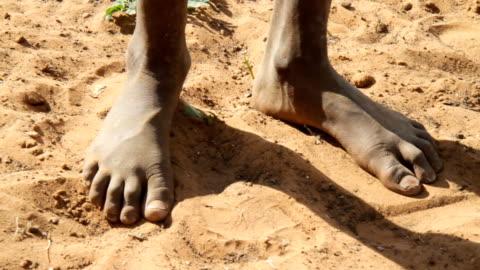 stockvideo's en b-roll-footage met cu feet of himba child - barefoot