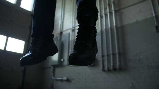 feet of man who committed suicide by hanging - hanging stock videos & royalty-free footage