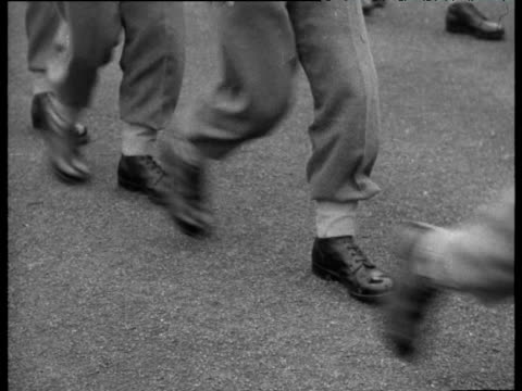 feet of national service soldiers march in line and about turn tilt up as soldiers march off 1956 - 1956 stock-videos und b-roll-filmmaterial