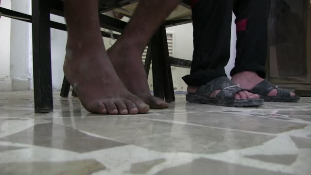 feet of of detainees suspected to be isis or isil militants captured by fighters of the kurdish people's protection units ypg on october 13, 2014 in... - barefoot stock videos & royalty-free footage