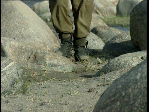 feet of patrolling afghan soldiers through barren landscape afghanistan - landscape scenery点の映像素材/bロール