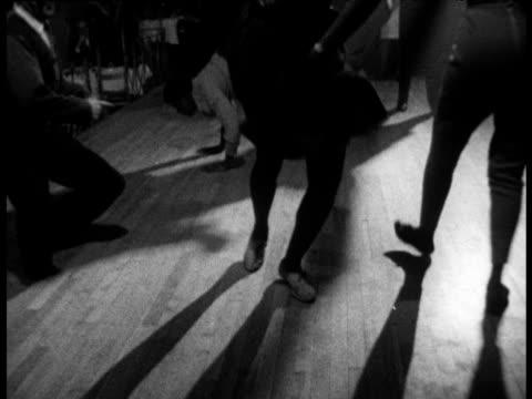 feet of people dancing 'hully gully' in harlem nightclub new york; 1960's - dance floor stock videos & royalty-free footage