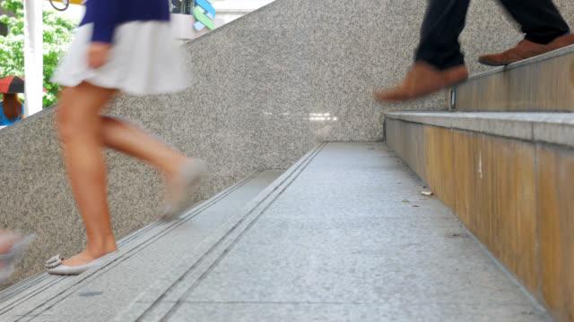 Feet of people walkingon overpass