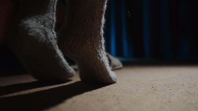 feet of person wearing wool socks tiptoe walking next to the bed - tiptoe stock videos & royalty-free footage