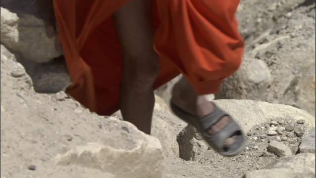 feet of pilgrim walking up mountain, tapovan, india available in hd. - orange colour stock videos & royalty-free footage