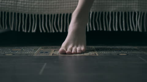 feet of woman getting out the bed in the morning - flooring stock videos & royalty-free footage