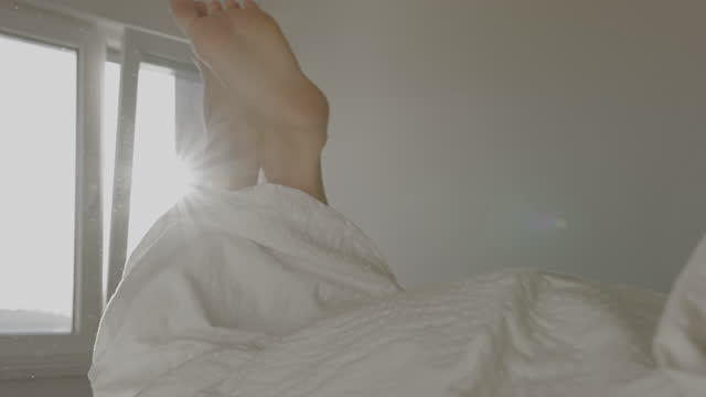 feet of woman wrapped in duvet - duvet stock videos & royalty-free footage