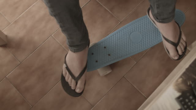feet on skateboard moving back and forth - flip flop stock videos and b-roll footage