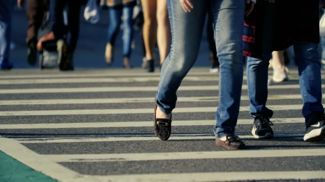 feet on the pedestrian zebra crossing - zebra crossing stock videos and b-roll footage