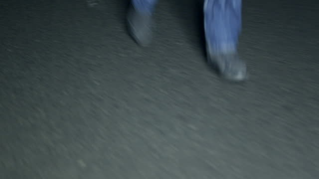 feet running on dark street - pursuit concept stock videos & royalty-free footage
