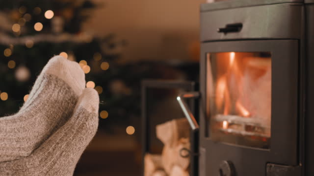 feet up in front of the fireplace at christmas - sock stock videos & royalty-free footage