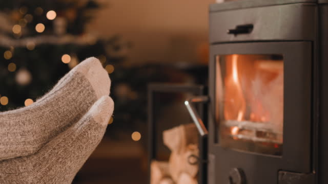 Feet up in front of the fireplace at Christmas