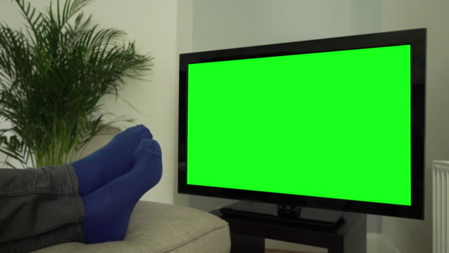 feet up, watching chromakey tv. - feet up stock videos & royalty-free footage