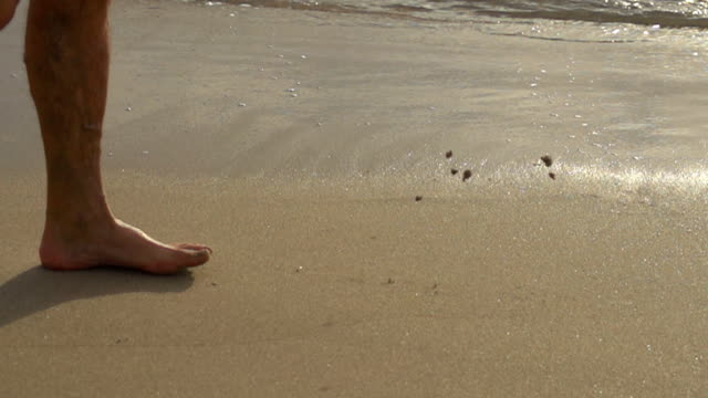 hd super slow motion: feet walking in sand - footprint stock videos and b-roll footage