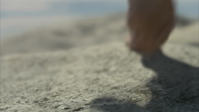Feet walking on cliffs close-up Huvudskar Stockholm archipelago Sweden.