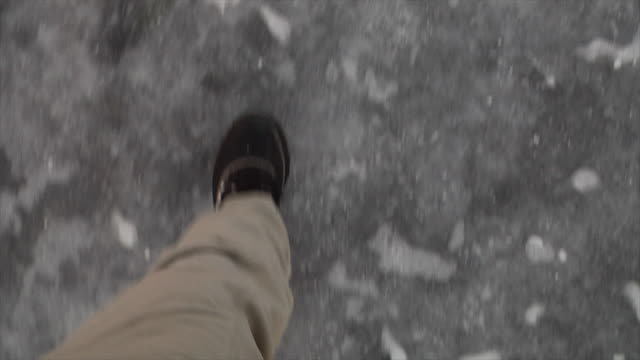 pov of feet walking on icy ground - slippery stock videos and b-roll footage