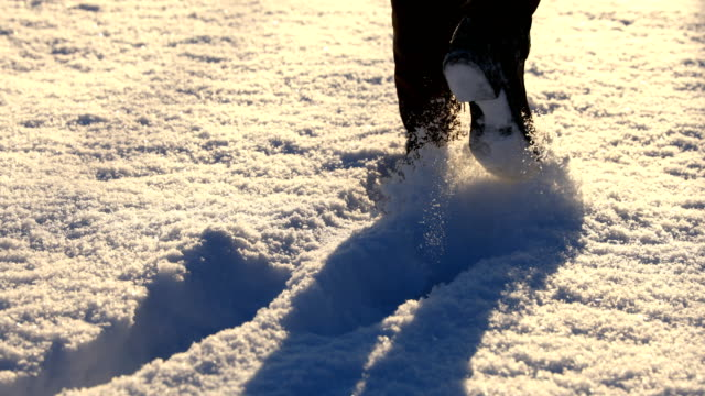 feet walking through snow - snowplough stock videos & royalty-free footage