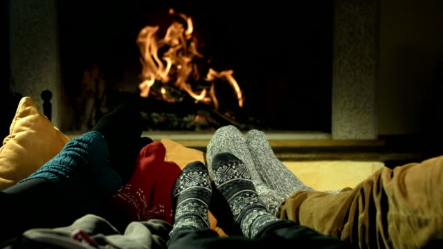HD DOLLY: Feet Warming At Fireplace