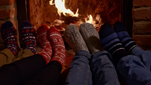 ds feet warming by fireplace - chalet stock videos & royalty-free footage